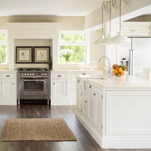 Inspiration for a timeless kitchen remodel in Dublin with beaded inset cabinets, white cabinets and an island