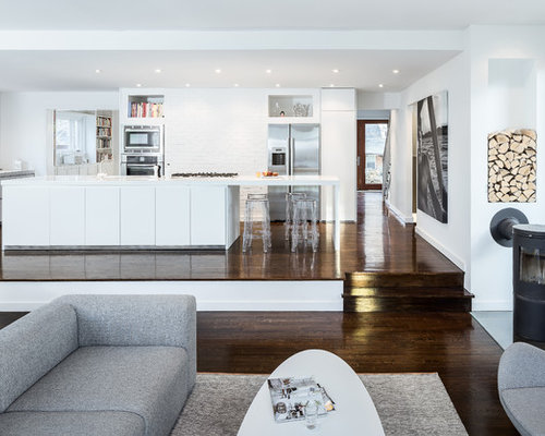 Large Danish Open Concept Dark Wood Floor Family Room Photo In DC Metro  With White Walls Part 61