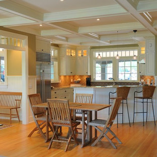 Traditional open concept kitchen ideas - Example of a classic l-shaped open concept kitchen design in Portland Maine with shaker cabinets, beige cabinets and stainless steel appliances
