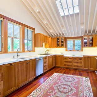 Trendy u-shaped kitchen photo in San Francisco with stainless steel appliances, an undermount sink, recessed-panel cabinets, medium tone wood cabinets and white backsplash