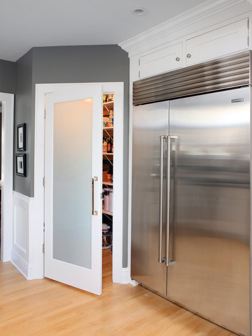 Inspiration for a large transitional galley light wood floor eat-in kitchen remodel in Chicago & Frosted Pantry Door   Houzz pezcame.com
