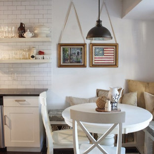 Inspiration for a mid-sized country galley eat-in kitchen in Austin with a double-bowl sink, open cabinets, white cabinets, granite benchtops, white splashback, subway tile splashback, stainless steel appliances, dark hardwood floors and no island.