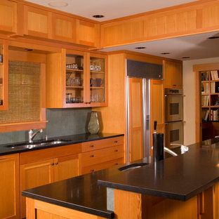 Design ideas for a large arts and crafts galley open plan kitchen in Seattle with an undermount sink, shaker cabinets, light wood cabinets, granite benchtops, grey splashback, slate splashback, panelled appliances, slate floors, a peninsula, multi-coloured floor and black benchtop.