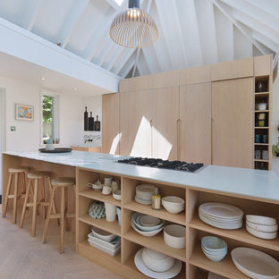 Inspiration for a medium sized scandi kitchen in London with flat-panel cabinets, light wood cabinets, marble worktops, light hardwood flooring, an island, beige floors and grey worktops.