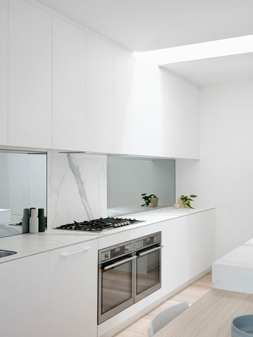 This Is An Example Of A Modern Galley Kitchen In Melbourne With Flat Panel  Cabinets