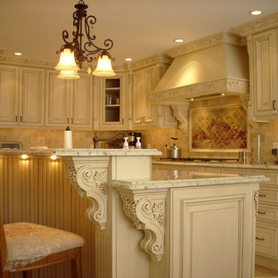 Example of a classic kitchen design in Philadelphia with raised-panel cabinets, beige cabinets and beige backsplash
