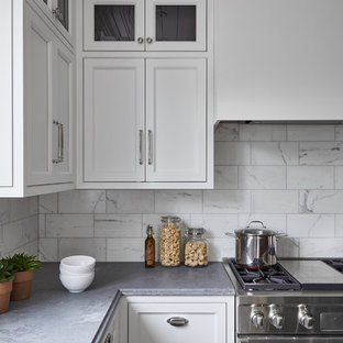 Mid-sized traditional l-shaped kitchen pantry in New York with an undermount sink, beaded inset cabinets, white cabinets, quartz benchtops, white splashback, marble splashback, stainless steel appliances, limestone floors, with island, grey floor and grey benchtop.