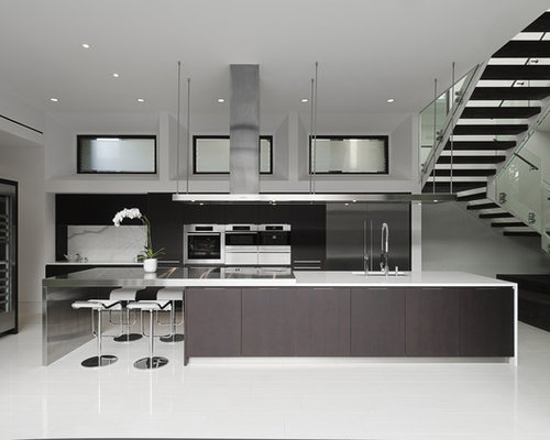 Poliform Kitchen Design. Example of a trendy galley open concept kitchen design in Houston with  stainless steel appliances Poliform Kitchens Houzz