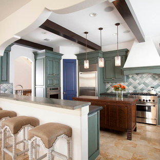 Tuscan kitchen photo in Houston with raised-panel cabinets, turquoise cabinets and stainless steel appliances