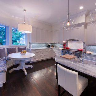 Large contemporary u-shaped kitchen pantry in Miami with blue splashback, stainless steel appliances, dark hardwood flooring and an island.