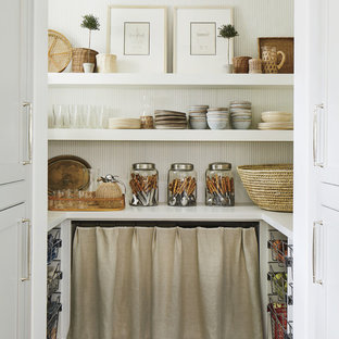 Beach style kitchen pantry inspiration - Inspiration for a beach style u-shaped black floor kitchen pantry remodel in Jacksonville with white countertops