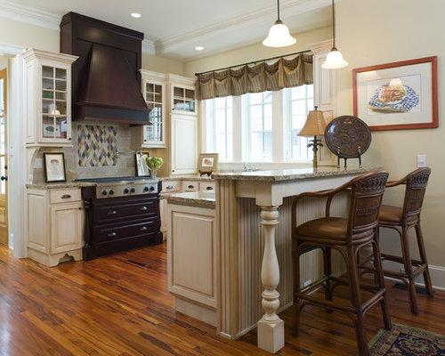 Example Of A Classic U Shaped Medium Tone Wood Floor Kitchen Design In  Birmingham With