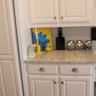 Design ideas for a large traditional u-shaped kitchen pantry in Dallas with a drop-in sink, raised-panel cabinets, white cabinets, granite benchtops, brown splashback, mosaic tile splashback, stainless steel appliances, ceramic floors and with island.