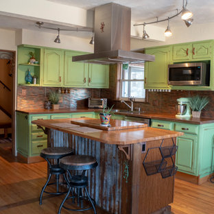 Photo of a mid-sized u-shaped eat-in kitchen in Denver with an undermount sink, concrete benchtops, stainless steel appliances, medium hardwood floors and with island.
