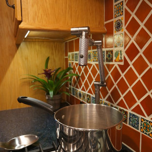 Small southwestern eat-in kitchen designs - Example of a small southwest l-shaped linoleum floor eat-in kitchen design in Philadelphia with an undermount sink, raised-panel cabinets, medium tone wood cabinets, quartz countertops, brown backsplash, terra-cotta backsplash, stainless steel appliances and no island
