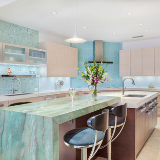Inspiration for a large contemporary u-shaped eat-in kitchen in Miami with an undermount sink, flat-panel cabinets, light wood cabinets, granite benchtops, green splashback, glass sheet splashback, panelled appliances, marble floors, multiple islands, brown floor and green benchtop.