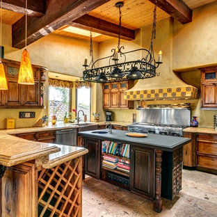 Huge southwestern kitchen ideas - Huge southwest u-shaped gray floor kitchen photo in San Diego with dark wood cabinets, granite countertops, stainless steel appliances, an island, a farmhouse sink and raised-panel cabinets