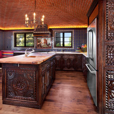 Mediterranean Kitchen by Carved Custom Cabinets