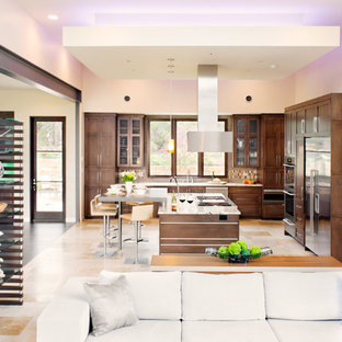 Example of a large trendy u-shaped travertine floor and beige floor open concept kitchen design in Austin with concrete countertops, shaker cabinets, dark wood cabinets, an island, an undermount sink, porcelain backsplash, stainless steel appliances and multicolored backsplash