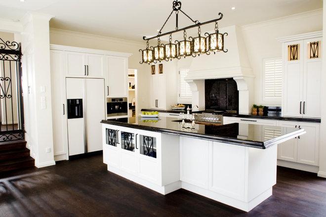 Mediterranean Kitchen by Mal Corboy Design and Cabinets