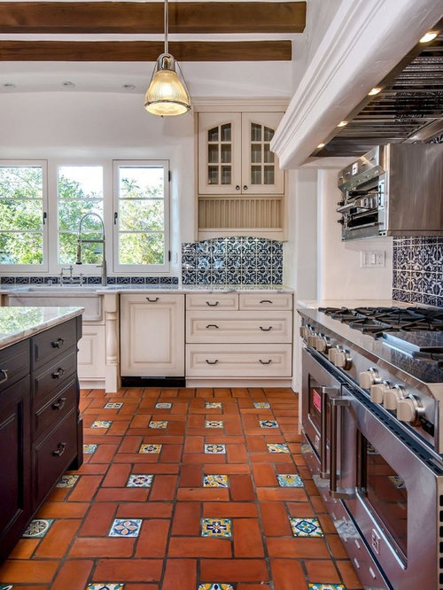 Kitchen with blue backsplash and terra cotta floors design ideas ...