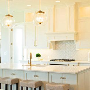 Transitional kitchen in Kansas City with a single-bowl sink, shaker cabinets, beige cabinets, beige splashback, panelled appliances, dark hardwood floors, with island, brown floor and beige benchtop.