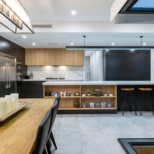 Inspiration for a large contemporary l-shaped eat-in kitchen in Brisbane with an undermount sink, light wood cabinets, marble benchtops, white splashback, marble splashback, stainless steel appliances, porcelain floors, with island, grey floor, white benchtop and flat-panel cabinets.