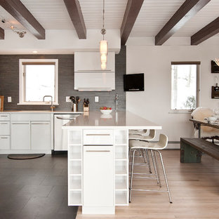 Trendy ceramic floor eat-in kitchen photo in New York with an undermount sink, flat-panel cabinets, white cabinets, quartz countertops, gray backsplash, ceramic backsplash and stainless steel appliances