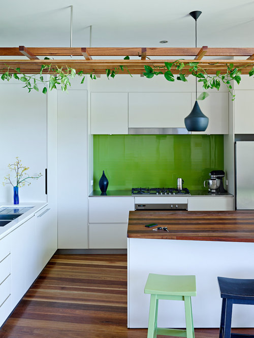 inspiration for a mid sized contemporary medium tone wood floor kitchen remodel in sunshine coast