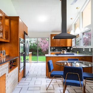 Design ideas for a midcentury u-shaped eat-in kitchen in Other with an undermount sink, flat-panel cabinets, medium wood cabinets, blue splashback, mosaic tile splashback, stainless steel appliances, a peninsula, white floor and white benchtop.