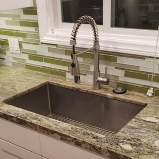 This is an example of a mid-sized contemporary kitchen in Los Angeles with a single-bowl sink, white cabinets, granite benchtops, green splashback and green benchtop.