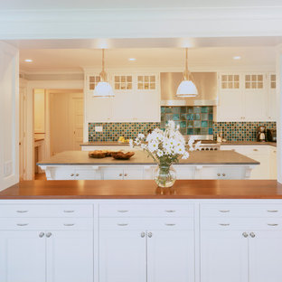 Traditional kitchen designs - Example of a classic kitchen design in Boston with wood countertops, white cabinets and mosaic tile backsplash