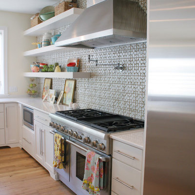 Kitchen - eclectic kitchen idea in Grand Rapids with open cabinets, white cabinets, gray backsplash and stainless steel appliances
