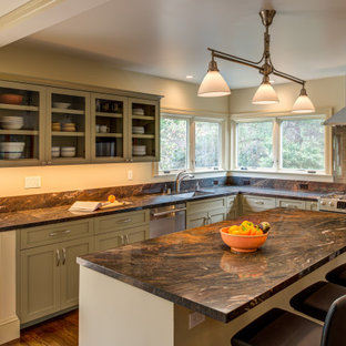 This is an example of a transitional l-shaped kitchen in San Francisco with an undermount sink, shaker cabinets, green cabinets, stainless steel appliances, dark hardwood floors, with island, brown floor, brown benchtop and granite benchtops.
