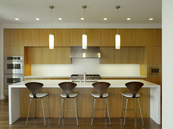 Modern Kitchen by Upscale Construction