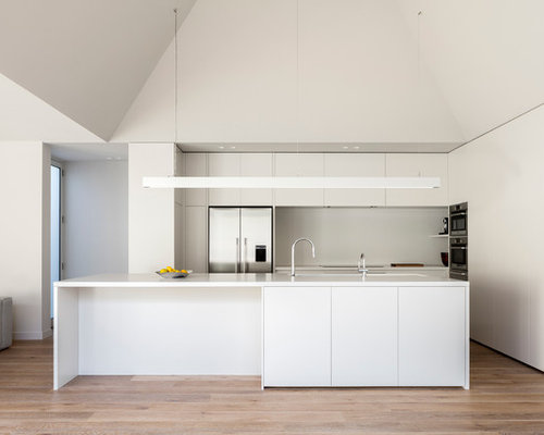 Photo Of A Modern Galley Eat In Kitchen In Melbourne With Grey Splashback,  Stainless