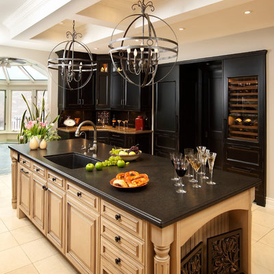 Elegant eat-in kitchen photo in Chicago with an undermount sink, raised-panel cabinets, black cabinets, quartz countertops and paneled appliances