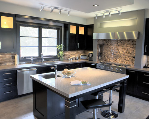 trendy kitchen photo in wilmington with a double bowl sink flat panel cabinets - Matchstick Tile Home Design