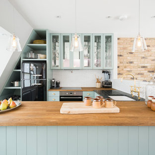 Design ideas for a transitional kitchen in London.