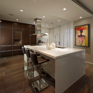 Trendy ceramic floor kitchen photo in Miami with an undermount sink, flat-panel cabinets, white cabinets and an island