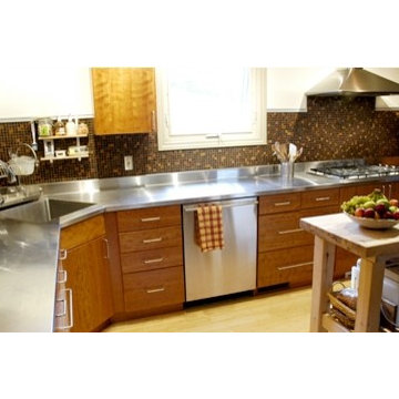 Stainless steel countertop with a corner sink by Ridalco