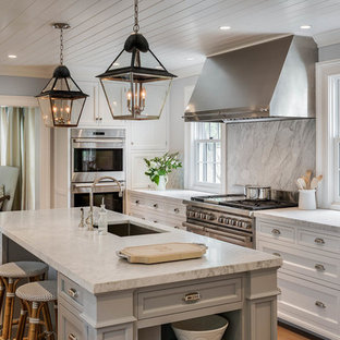 Large farmhouse enclosed kitchen designs - Enclosed kitchen - large cottage u-shaped light wood floor and brown floor enclosed kitchen idea in New York with an undermount sink, white cabinets, marble countertops, gray backsplash, stainless steel appliances, an island, marble backsplash and recessed-panel cabinets