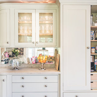 Design ideas for a small traditional l-shaped eat-in kitchen in Berkshire with a farmhouse sink, shaker cabinets, grey cabinets, limestone benchtops, mirror splashback, panelled appliances, ceramic floors and no island.