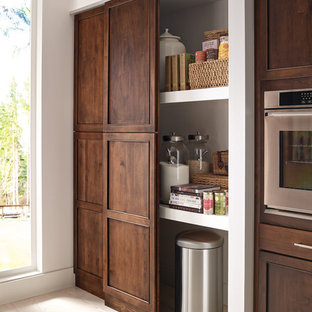 Large traditional single-wall kitchen pantry in Other with an island, a submerged sink, recessed-panel cabinets, medium wood cabinets, stainless steel appliances, light hardwood flooring and beige floors.