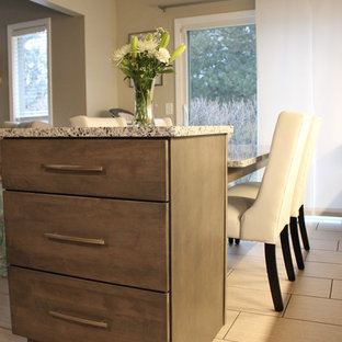 Mid-sized transitional enclosed kitchen photos - Mid-sized transitional l-shaped porcelain tile and gray floor enclosed kitchen photo in Detroit with a single-bowl sink, shaker cabinets, gray cabinets, granite countertops, white backsplash, ceramic backsplash, stainless steel appliances, an island and gray countertops