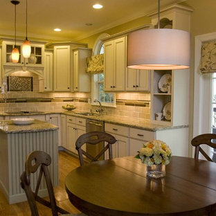 Mid-sized traditional eat-in kitchen designs - Inspiration for a mid-sized timeless l-shaped light wood floor eat-in kitchen remodel in Charlotte with an undermount sink, recessed-panel cabinets, white cabinets, multicolored backsplash, stainless steel appliances and an island
