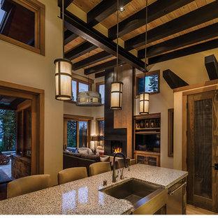 Идея дизайна: кухня-гостиная в стиле кантри с раковиной в стиле кантри, столешницей терраццо и островом