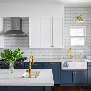Transitional kitchen ideas - Kitchen - transitional brown floor and dark wood floor kitchen idea in San Francisco with a farmhouse sink, quartz countertops, white backsplash, stainless steel appliances, an island, white countertops, shaker cabinets, blue cabinets and subway tile backsplash