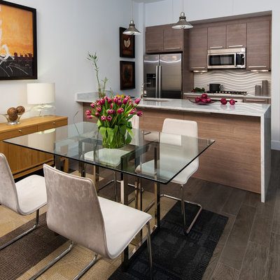 Example of a trendy galley eat-in kitchen design in DC Metro with flat-panel cabinets, dark wood cabinets and stainless steel appliances