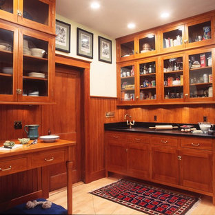 Traditional kitchen ideas - Inspiration for a timeless kitchen remodel in Boston with glass-front cabinets